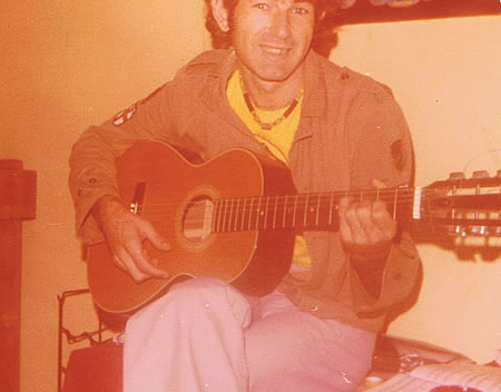 John Perth playing guitat 1977